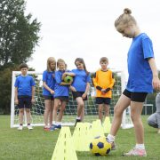 Coach Leading Outdoor Soccer Training Session